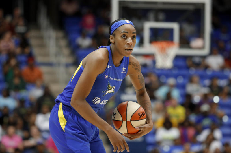 Dallas Wings' Glory Johnson handles the ball during a WNBA basketball game against the Los Angeles Sparks in Arlington, Texas, Wednesday, Aug. 14, 2019. (AP Photo/Tony Gutierrez)