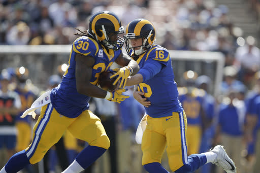 FILE - In this Sunday, Oct. 8, 2017, file photo, Los Angeles Rams quarterback Jared Goff (16) hands the ball to Todd Gurley (30) during an NFL football game against the Seattle Seahawks, in Los Angeles. The Rams have gone from one of the NFL's biggest surprises to one of the top Super Bowl favorites in just one year. (AP Photo/Jae C. Hong, File)