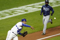Kansas City Royals catcher Salvador Perez, left, throws to first for a double play hit into by Tampa Bay Rays' Francisco Mejia after forcing out Randy Arozarena, right, out at home during the sixth inning of a baseball game Monday, April 19, 2021, in Kansas City, Mo. (AP Photo/Charlie Riedel)