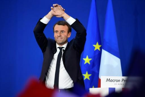 Investors cheer Macron, but worry about parliament backing