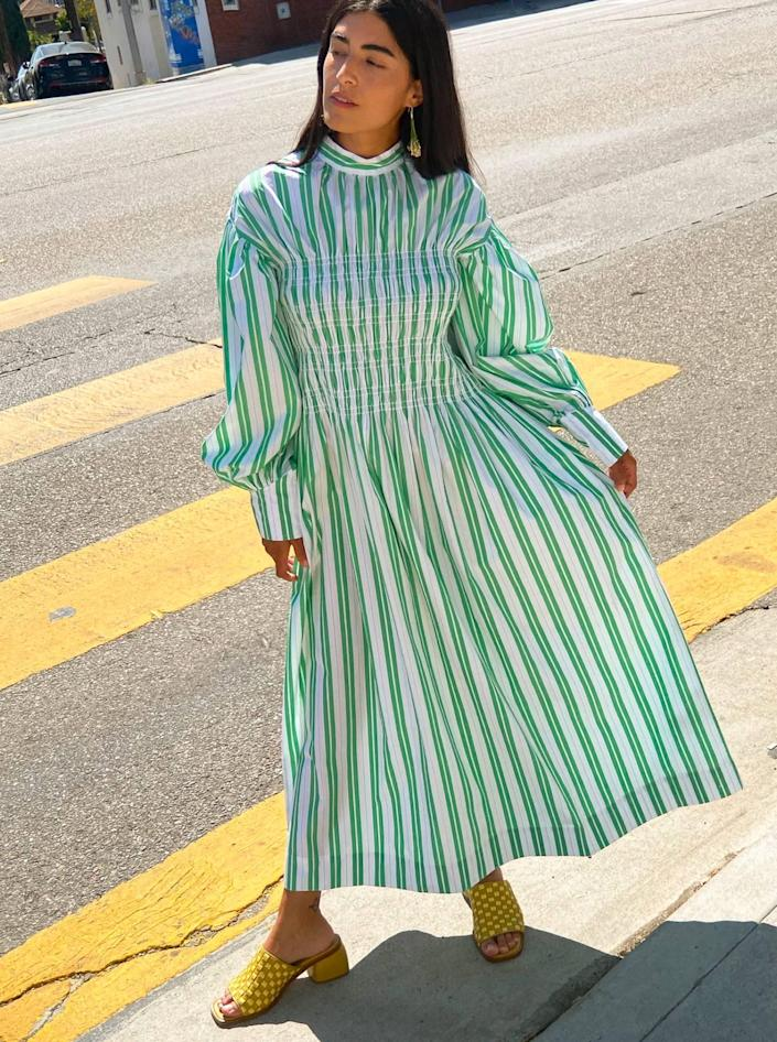 """Hit 'em with some stripes, volume, and high-neck action courtesy of Ganni. $325, Lisa Says Gah. <a href=""""https://lisasaysgah.com/collections/dresses/products/smock-dress-kelly-green"""" rel=""""nofollow noopener"""" target=""""_blank"""" data-ylk=""""slk:Get it now!"""" class=""""link rapid-noclick-resp"""">Get it now!</a>"""