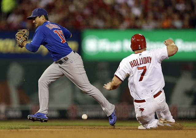 St. Louis Cardinals' Matt Holliday, right, is forced out at second as Chicago Cubs second baseman Darwin Barney drops the ball trying to turn the double play during the fourth inning of a baseball game Friday, Sept. 27, 2013, in St. Louis. The Cardinals' Yadier Molina was out at first and Carlos Beltran scored on the play. (AP Photo/Jeff Roberson)