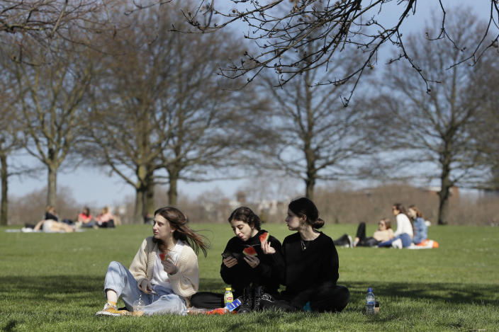 FILE - In this Monday, March 29, 2021 file photo, groups of people picnic in Hyde Park, London, as lockdown easing begins. British Prime Minister Boris Johnson is expected to give the go-ahead for that much-missed human contact when he announces the next round of lockdown easing later Monday May 10, 2021, in the wake of a sharp fall in new coronavirus infections. (AP Photo/Kirsty Wigglesworth, File)