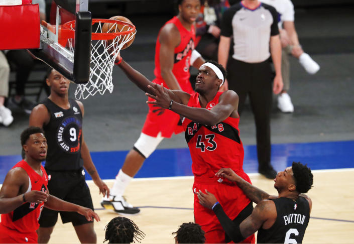 Toronto Raptors forward Pascal Siakam (43) goes to the basket against New York Knicks guard Elfrid Payton (6) during the first half of an NBA basketball game Saturday, April 24, 2021, in New York. (AP Photo/Noah K. Murray)