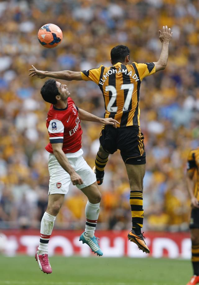 Arsenal's Mikel Arteta, left, challenges Hull City's Ahmed El mohamady during the English FA Cup final soccer match between Arsenal and Hull City at Wembley Stadium in London, Saturday, May 17, 2014. (AP Photo/Kirsty Wigglesworth)