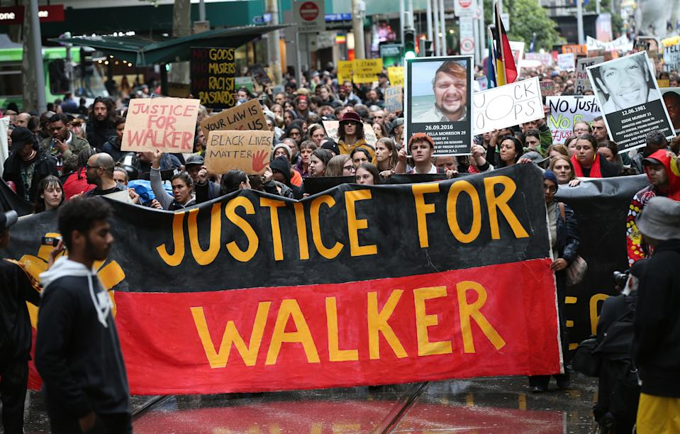 Aboriginal and Torres Strait Islanders communities and allies march during a protest in Melbourne, Wednesday, November 13, 2019. Aboriginal and Torres Strait Islander communities and allies are calling for justice for 19-year-old Warlpiri teenager Kumanjayi Walker, who died after being shot by police on Saturday night in the central desert town of Yuendumu in the Northern Territory. (AAP Image/David Crosling) NO ARCHIVING