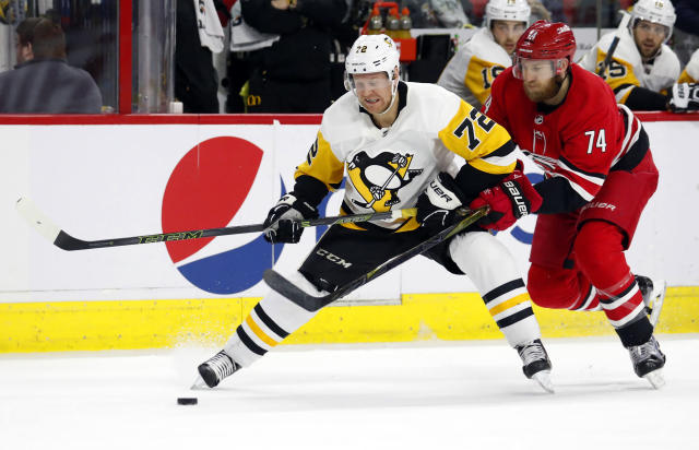 Pittsburgh Penguins' Patric Hornqvist (72) is pestered by Carolina Hurricanes' Jaccob Slavin (74) during the second period of an NHL hockey game, Saturday, Dec. 22, 2018, in Raleigh, N.C. (AP Photo/Karl B DeBlaker)