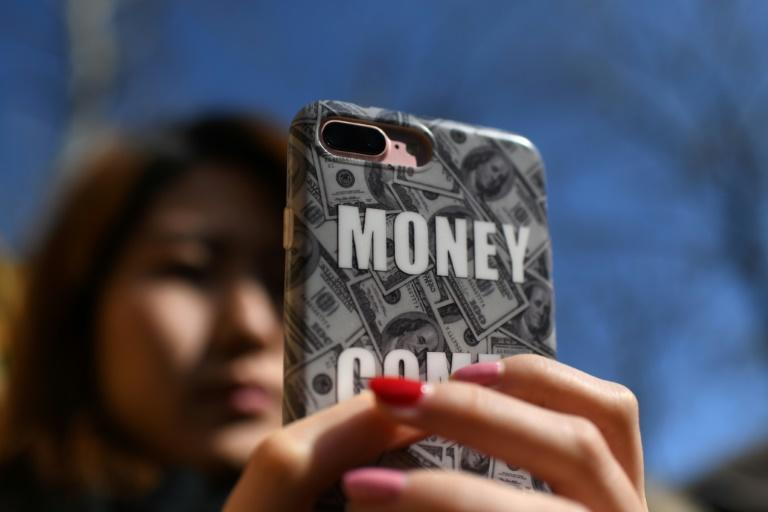 Smartphones have made it even easier for consumers to borrow cash in China and a number of online platforms have listed publicly in the US this year