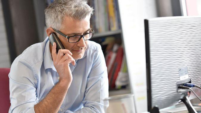 businessman-office-talking-on-the-phone