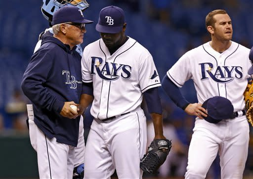 Tampa Bay Rays manager Joe Maddon, left, removes relief pitcher Fernando Rodney, center, as Evan Longoria looks on during the ninth inning of a baseball game against the Toronto Blue Jays Monday, May 6, 2013, in St. Petersburg, Fla. The Blue Jays won 8-7. (AP Photo/Mike Carlson)