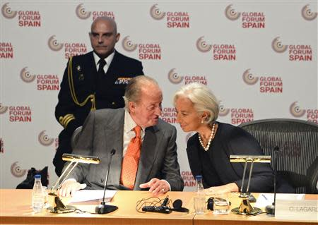 Spanish King Juan Carlos and IMF Managing Director Christine Lagarde attend the Global Forum Spain economic conference in Bilbao, March 3, 2014. REUTERS/Vincent West