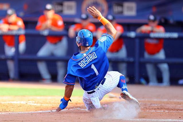 <p>New York Mets shortstop Amed Rosario (1) slides home safely in the fifth inning of a baseball game against the Miami Marlins at First Data Field in Port St. Lucie, Fla., Feb. 25, 2018. (Photo: Gordon Donovan/Yahoo News) </p>