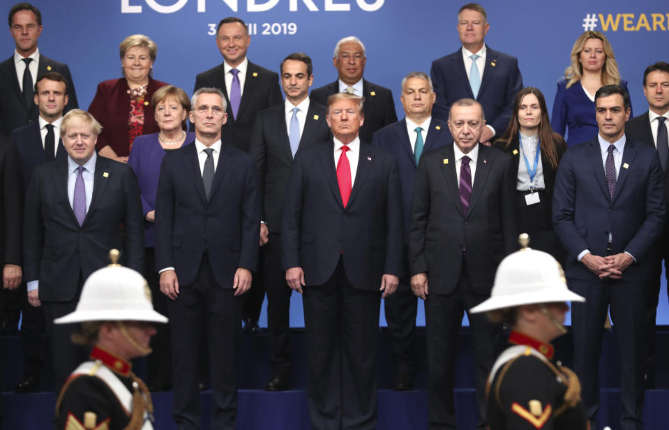 From front row left, British Prime Minister Boris Johnson, NATO Secretary General Jens Stoltenberg, U.S. President Donald Trump, Turkish President Recep Tayyip Erdogan and Spanish Prime Minister Pedro Sanchez attend a ceremony event during a NATO leaders meeting at The Grove hotel and resort in Watford, Hertfordshire, England, Wednesday, Dec. 4, 2019. NATO Secretary-General Jens Stoltenberg rejected Wednesday French criticism that the military alliance is suffering from brain death, and insisted that the organization is adapting to modern challenges. (AP Photo/Francisco Seco)