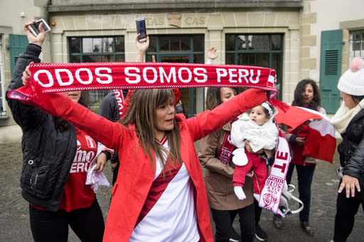 Supporters of Peruvian soccer players Jose Paolo Guerrero stand outside the international Court of Arbitration for Sport, CAS, during a hearing on Guerrero's doping ban in Lausanne, Switzerland, Thursday, May 3, 2018. (Jean-Christophe Bott/Keystone via AP)