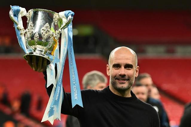 Manchester City manager Pep Guardiola urged fans to follow experts' advice on coronavirus (AFP Photo/Glyn KIRK )
