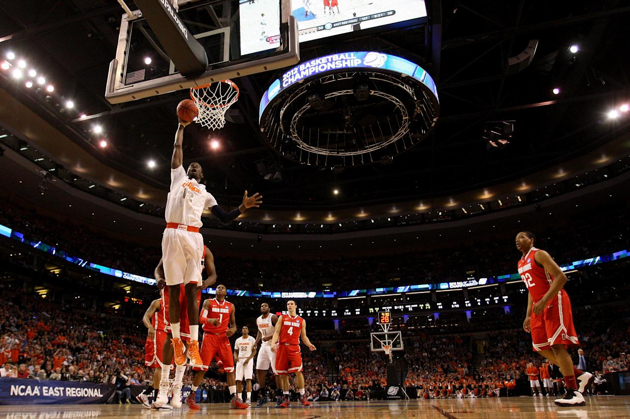 BOSTON, MA - MARCH 24:  Baye Keita #12 of the Syracuse Orange dunks the ball against the Ohio State Buckeyes during the 2012 NCAA Men's Basketball East Regional Final at TD Garden on March 24, 2012 in Boston, Massachusetts.  (Photo by Jim Rogash/Getty Images)