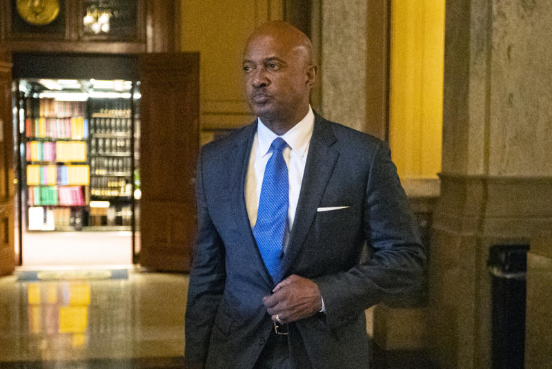Indiana Attorney General Curtis Hill arrives for a hearing at the state Supreme Court in the Statehouse, Wednesday, Oct. 23, 2019, in Indianapolis. Hill faces a hearing over whether allegations that he drunkenly groped four women at a bar amounted to professional misconduct.  (AP Photo/Michael Conroy)
