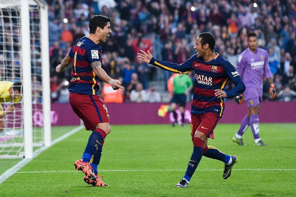 Barcelona's Luis Suarez (L) is congratulated by Neymar after scoring a goal during a Spanish La Liga match at the Camp Nou stadium in Barcelona, on November 8, 2015 (AFP Photo/Josep Lago)