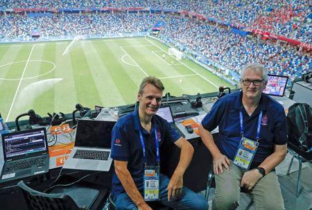 Reuters journalists Andrew Cawthorne (L) and Mark Gleeson sit in the media tribune during the match between Croatia and Denmark at the Nizhny Novgorod Stadium, Nizhny Novgorod, Russia, July 1, 2018. REUTERS/Max Rossi