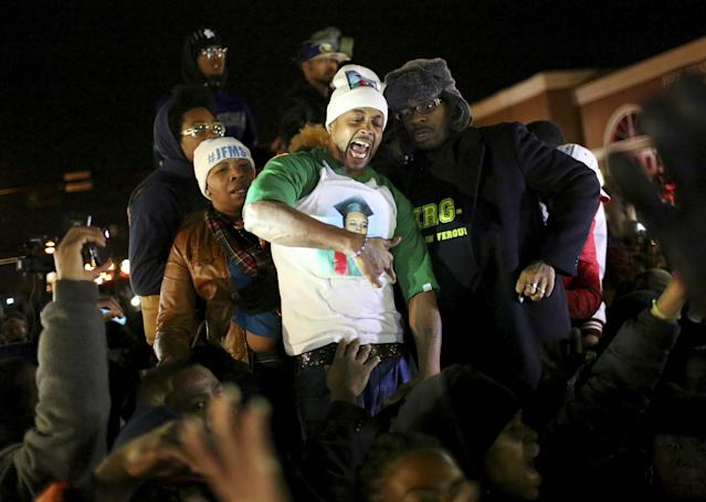<p>Michael Brown's stepfather,center, in St. Louis, Missouri on November 14, 2014, urged protesters to 'Burn this bitch down' after learning of a grand jury's decision to not indict Ferguson, Missouri, police officer Darren Wilson. Wilson shot and killed Brown, 18, on August 9. Brown's stepfather is being criticized for urging the crowd to riot after grand jury decision. (Timothy Tai/ZUMA Wire/ZUMAPRESS.com) </p>