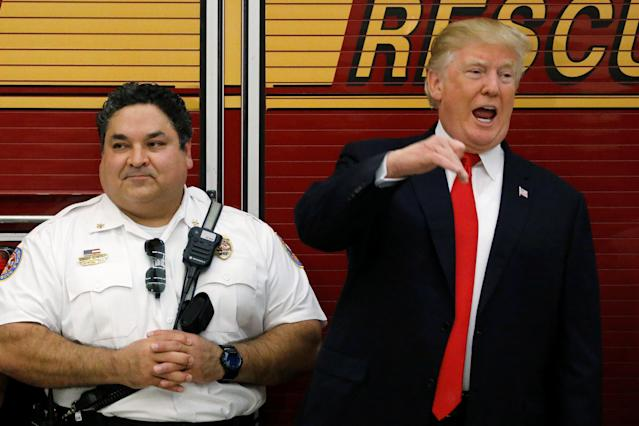 <p>U.S. President Donald Trump delivers remarks as he greets members of the West Palm Beach Fire Rescue squads at one of their stations in West Palm Beach, Florida, U.S. December 27, 2017. REUTERS/Jonathan Ernst </p>