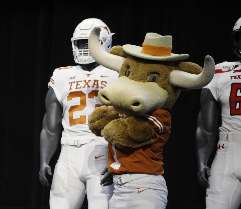 Texas mascot Hook'em poses on stage with team uniforms on the first day of Big 12 Conference NCAA college football media days Monday, July 15, 2019, at AT&T Stadium in Arlington, Texas. (AP Photo/David Kent)