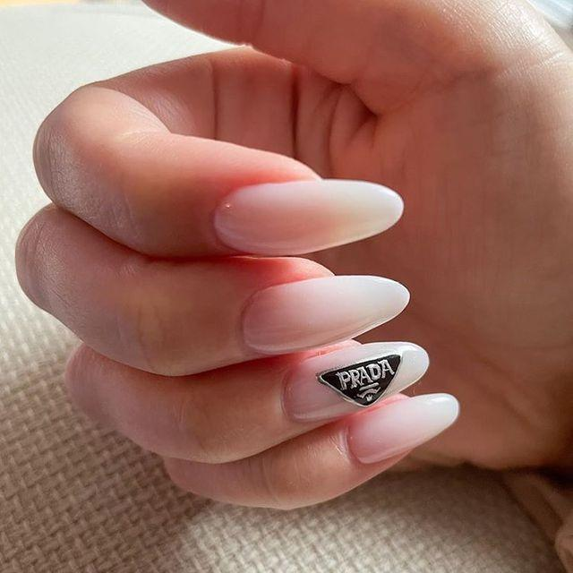 "<p>This chic, nude manicure by Aki Hirayama is almost understated, but the label on the accent nail takes it to another level.</p><p><a href=""https://www.instagram.com/p/CH_fqv7j84g/"" rel=""nofollow noopener"" target=""_blank"" data-ylk=""slk:See the original post on Instagram"" class=""link rapid-noclick-resp"">See the original post on Instagram</a></p>"