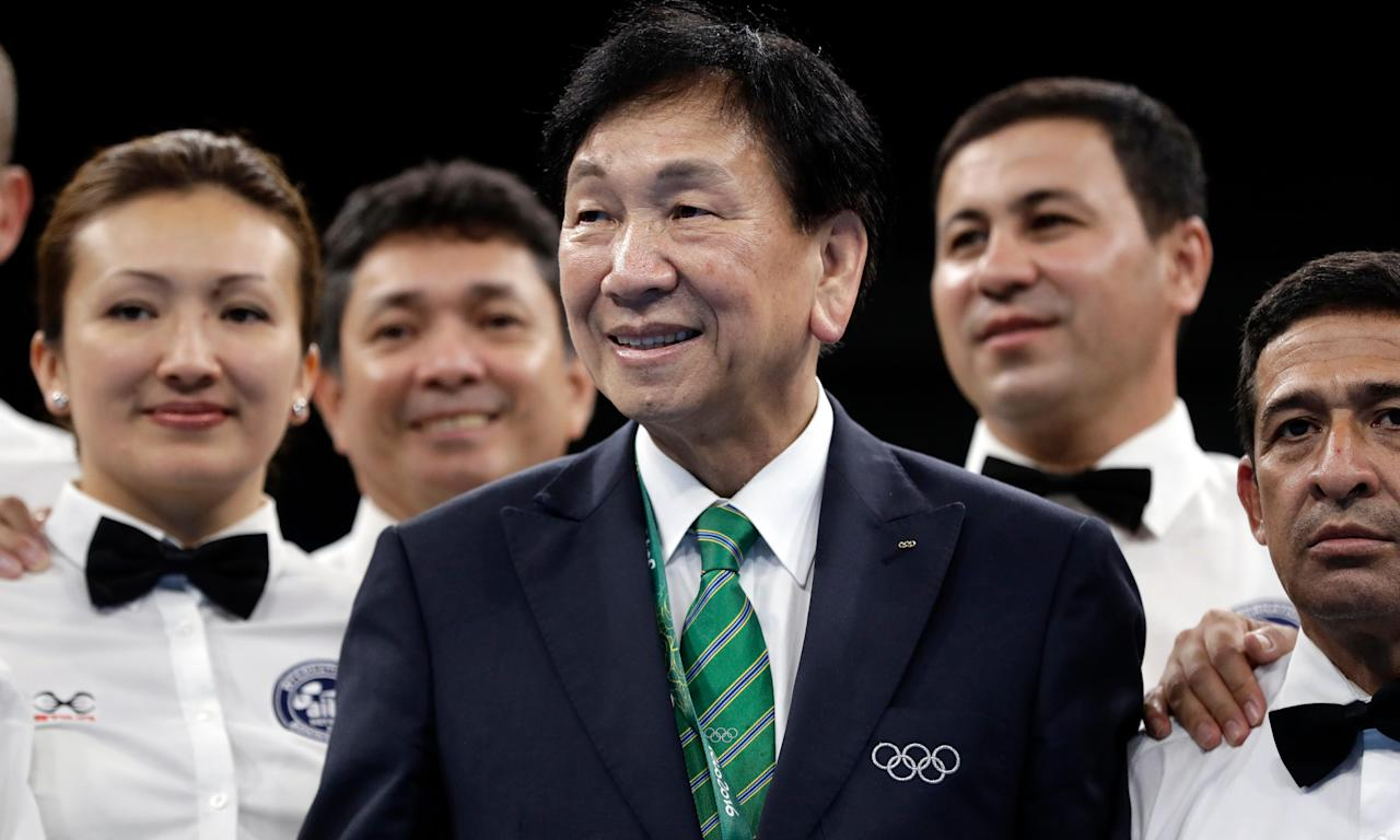 AIBA President Wu Ching-kuo picture with referees in the ring after the final matches at the 2016 Summer Olympics in Rio.