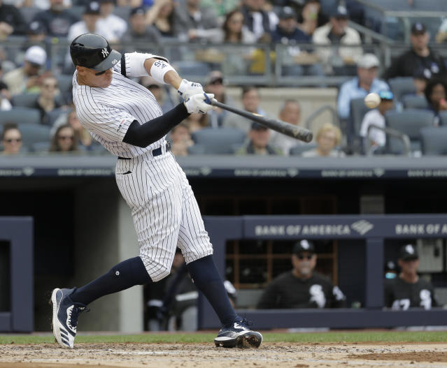New York Yankees' Aaron Judge hits an RBI single during the third inning of a baseball game against the Chicago White Sox, Sunday, April 14, 2019, in New York. (AP Photo/Seth Wenig)