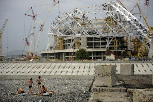 """Workers take a break near the 'Fisht' Olympic stadium, which is under construction for the Sochi 2014 Winter Olympics. Russia on Wednesday set itself the """"unbelievably"""" tough target of finishing top of the podium at its home Winter Olympic Games after placing a humiliating 11th two years ago"""