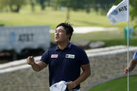 Kyoung-Hoon Lee, of South Korea, reacts after his putt on the 18th green during the third round of the AT&T Byron Nelson golf tournament, Saturday, May 15, 2021, in McKinney, Texas. (AP Photo/Tony Gutierrez)