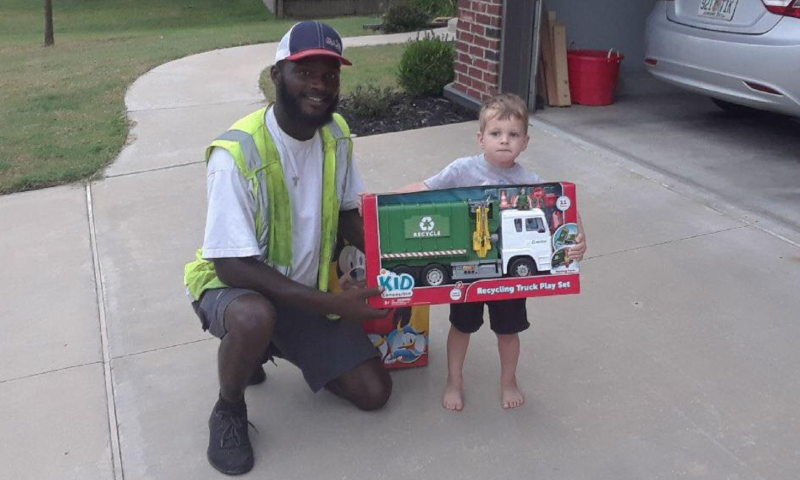Aaron Mitchell, with American Waste Control, surprised a young fan in Jenks, Oklahoma with his very own recycling truck. (Photo: Facebook)