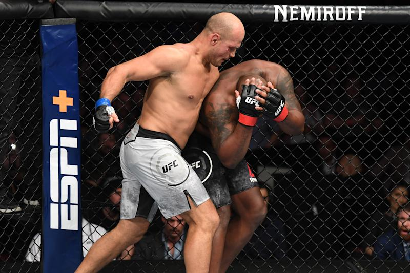WICHITA, KS - MARCH 09: (L-R) Junior Dos Santos of Brazil punches Derrick Lewis in their heavyweight bout during the UFC Fight Night event at Intrust Bank Arena on March 9, 2019 in Wichita, Kansas. (Photo by Josh Hedges/Zuffa LLC/Zuffa LLC via Getty Images)