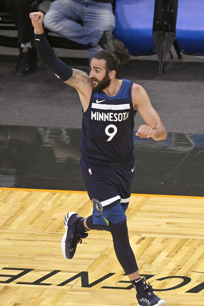 Minnesota Timberwolves guard Ricky Rubio reacts after scoring a 3-point basket during the second half of the team's NBA basketball game against the Orlando Magic, Sunday, May 9, 2021, in Orlando, Fla. (AP Photo/Phelan M. Ebenhack)