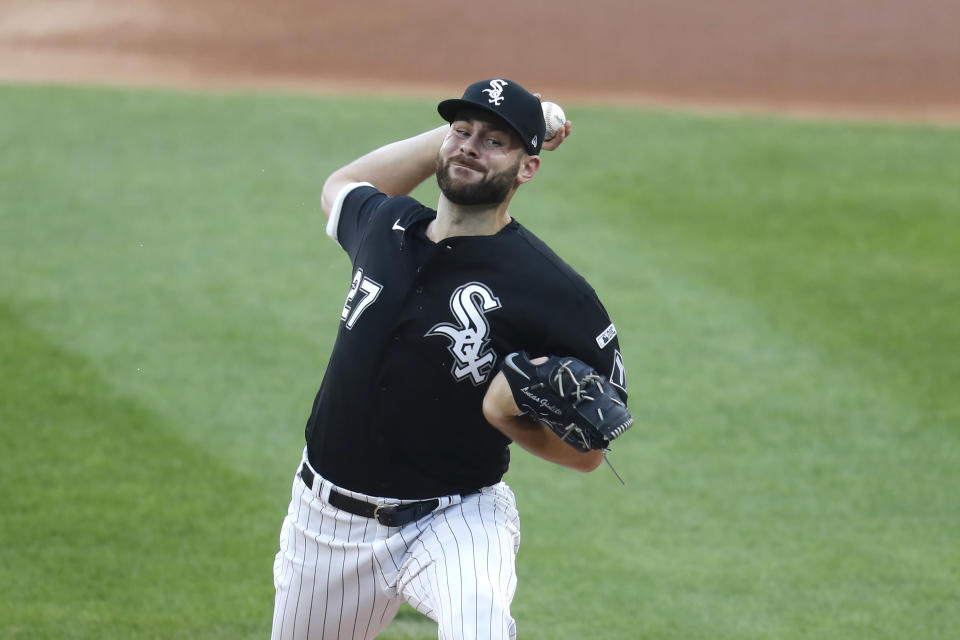 Chicago White Sox starting pitcher Lucas Giolito delivers during the first inning of a baseball game against the Minnesota Twins Friday, July 24, 2020, in Chicago. (AP Photo/Charles Rex Arbogast)