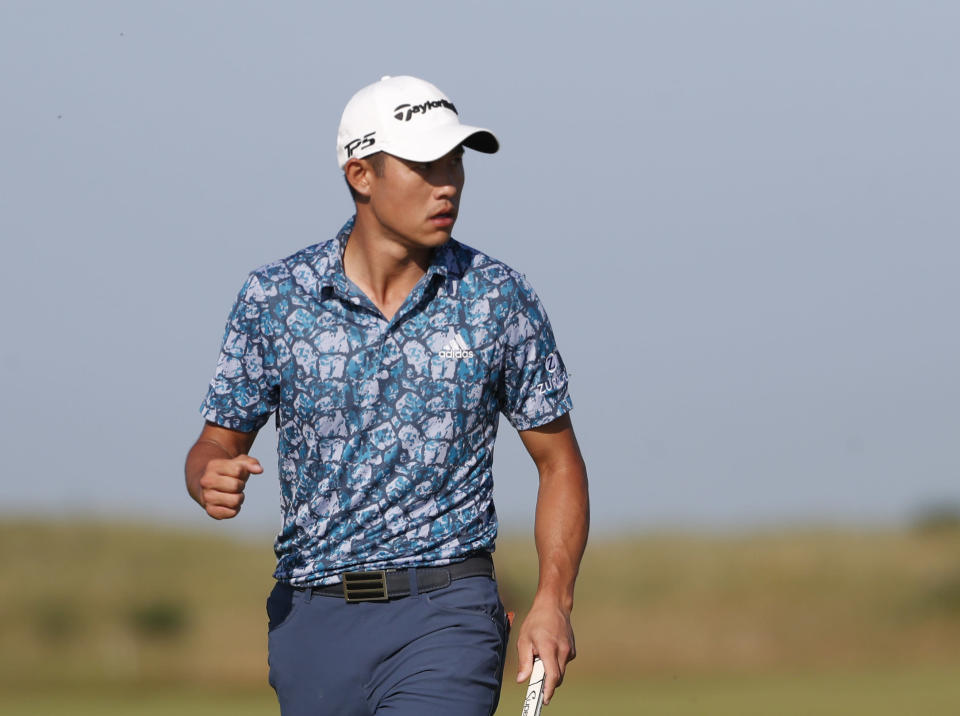 United States' Collin Morikawa celebrates after a birdie putt on the 14th hole during the final round of the British Open Golf Championship at Royal St George's golf course Sandwich, England, Sunday, July 18, 2021. (AP Photo/Peter Morrison)