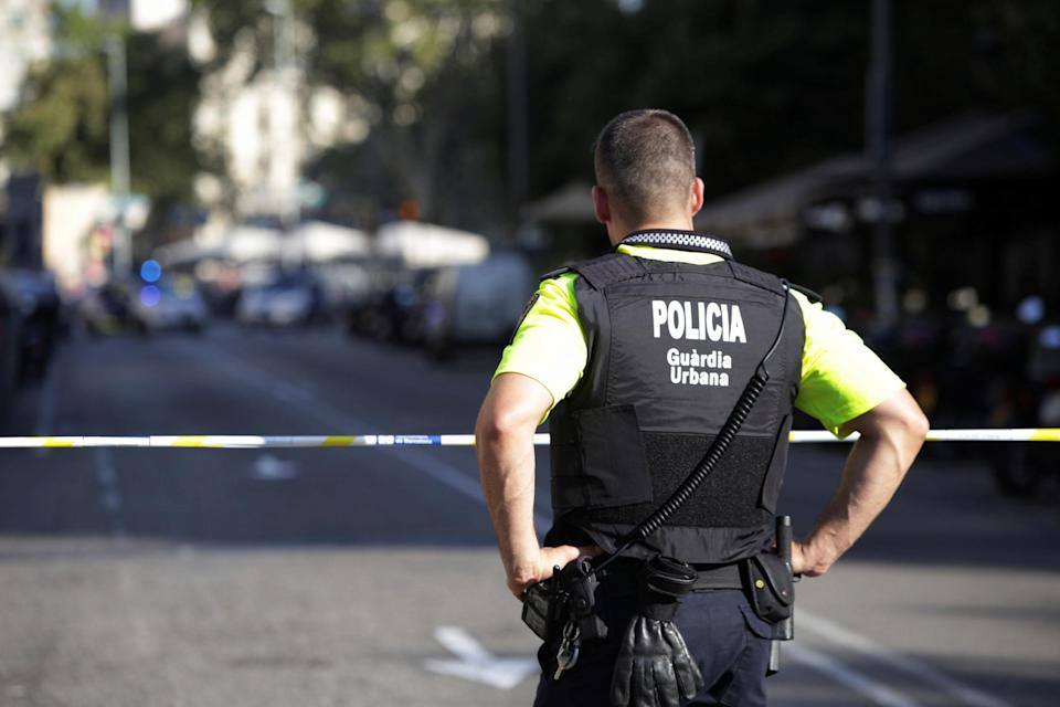 <p>A police officer stands by a cordoned off street after a van crashed into pedestrians near the Las Ramblas avenue in central Barcelona, Spain, August 17, 2017. (REUTERS/Stringer) </p>