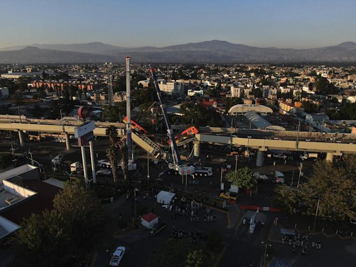 An aerial view of subway cars from a collapsed elevated section of the Metro line in Mexico City on Tuesday.