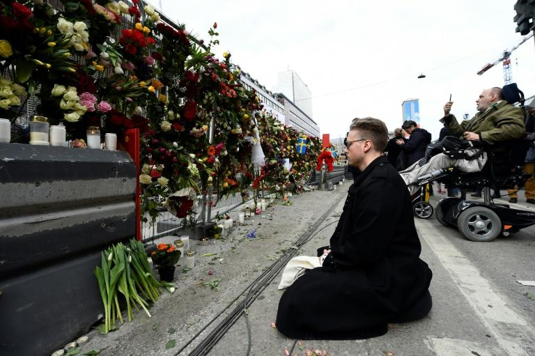 Shocked Swedes remember victims of Friday's lorry attack on a crowded Stockholm street