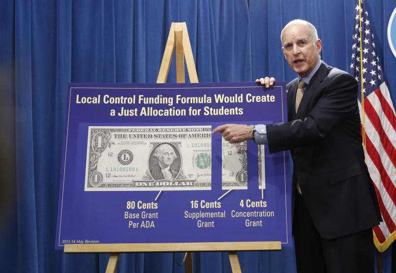FILE -- In this May 14, 2013 file photo, Gov. Jerry Brown gestures to a chart showing his plan to give more local control over education funding as he discussed his updated 2013-14 state budget plan at the Capitol in Sacramento, Calif. In his second stint as California's chief executive, Brown has received wide praise for bringing the state's massive budget deficit into line and enters the final year of his third term with a 58 percent approval rating.(AP Photo/Rich Pedroncelli, File)