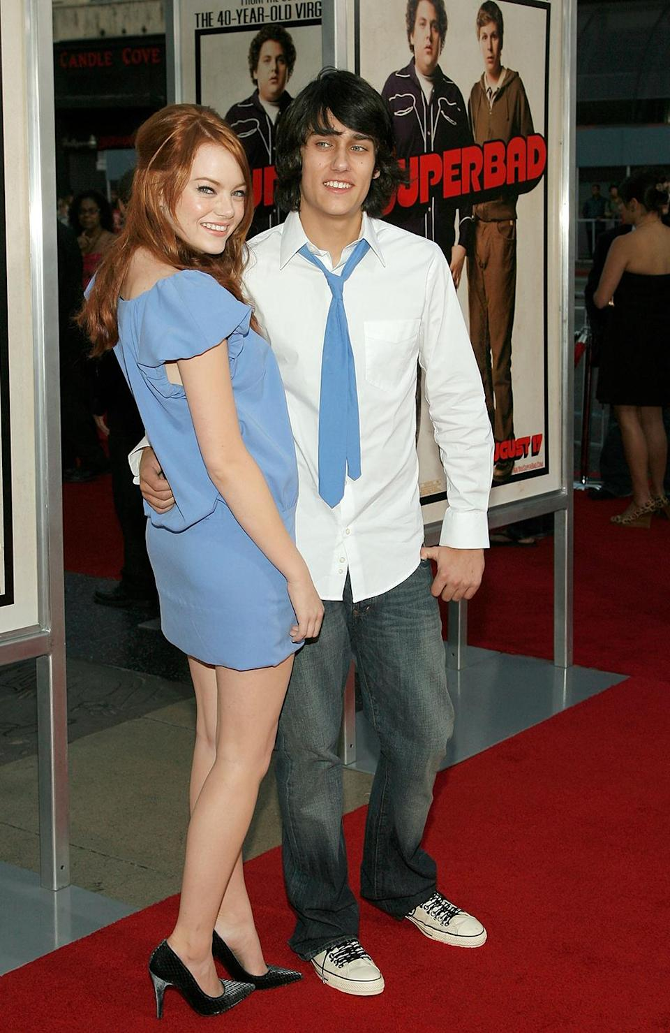 <p>Stone makes her feature-film debut in the comedy <em>Superbad,</em> co-starring Johan Hill and Michael Cera. She arrives to the premiere on Aug. 13, 2007, with then boyfriend and fellow <em>In Search of the Partridge Family</em> contestant Teddy Geiger. (Photo: Vince Bucci/Getty Images) </p>