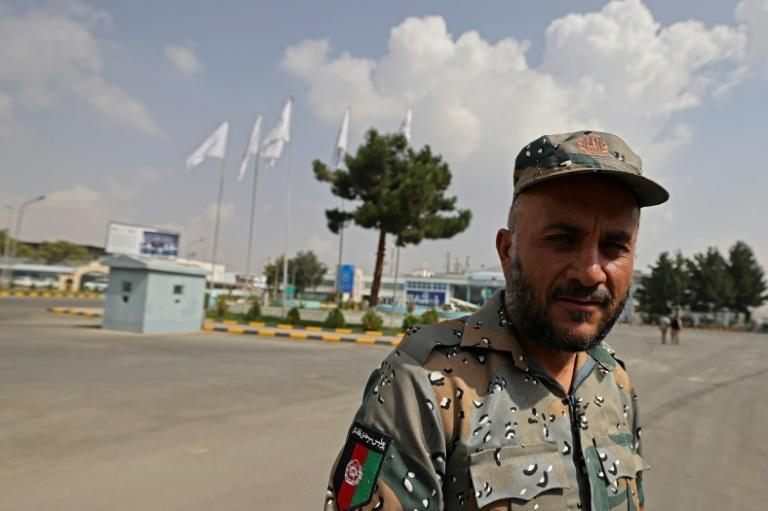 When the Taliban swept into Kabul last month ousting the government, police abandoned their posts, fearful of what the Islamists would do (AFP/Karim SAHIB)