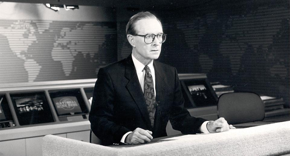 A 1990 supplied photo of former Bandstand host and channel Nine newsreader Brian Henderson on the Nine news set. Source: AAP/Nine