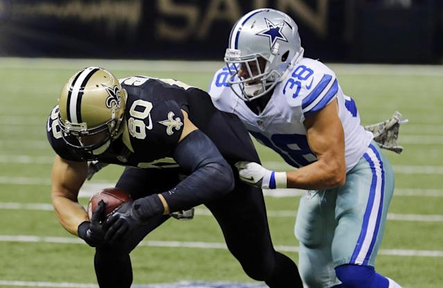 New Orleans Saints tight end Jimmy Graham (80) carries for a first down on a pass play as Dallas Cowboys defensive back Jeff Heath (38) covers in the first half of an NFL football game in New Orleans, Sunday, Nov. 10, 2013. (AP Photo/Bill Haber)
