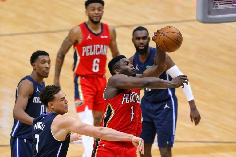New Orleans' star Zion Williamson drives to the basket in the Pelicans' 112-103 NBA victory over the Dallas Maverics