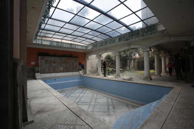 CORRECTS DAY OF WEEK - The mansion of Chinese-Mexican businessman Zhenli Ye Gon during a media tour in Mexico City, Tuesday, July 30, 2019. The federal government said Monday it will hold an Aug. 11 auction for the Mexico City mansion worth $5 million (95 million Mexican pesos) that previously belonged to the suspected drug trafficker. (AP Photo/Ginnette Riquelme)