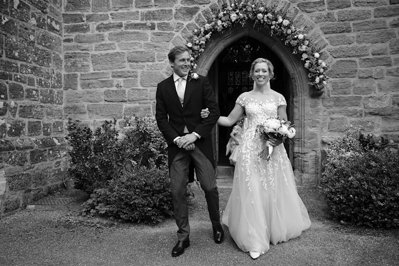 We were both beaming with joy as we left the church through the flower arch to the bells pealing out.