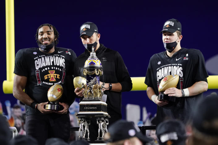 From left; Iowa State linebacker and defensive player of the game O'Rien Vance, head coach Matt Campbell and offense player of the game, quarterback Brock Purdy celebrate after the Fiesta Bowl NCAA college football game against Oregon, Saturday, Jan. 2, 2021, in Glendale, Ariz. Iowa State won 34-17. (AP Photo/Rick Scuteri)