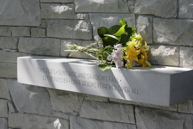 Flowers are left at the Air India memorial in Vancouver on July 27, 2007.