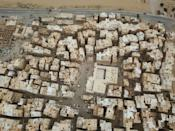 The traditional mud-brick architecture of Yemen's Hadramawt region is well suited to the climate but needs constant repairs -- this photograph is of Sayf village